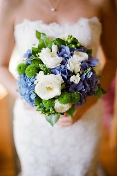 Blue hydrangeas and white ranunculus wedding bouquet with green poms poms. Beautifully captured by Mreredith Perdue