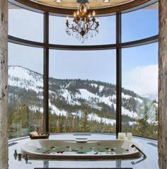 Large contemporary bathroom with mountain view.