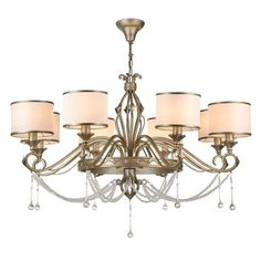 Add a touch of class to your home with a classic crystal, brass, gold or antique chandelier. Enjoy FREE and fast delivery to most of the UK on orders over Shop online now! Black Iron Chandelier, Empire Chandelier, Iron Chandeliers, Candle Chandelier, Antique Chandelier, Chandelier Shades, Chandelier Lighting, Wagon Wheel Chandelier, Light Covers