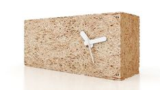 Wood wool is a material made from leftover slivers cut from logs – it's mainly used in packaging, filling, or bonded to form boards. As a celebration of this wonderful eco-friendly material, Italian designer Valerio Romondia created a simple eco-friendly clock using a single wood wool brick and a standard set of recycled aluminum hands.