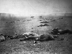 July 1863, Gettysburg, Pennsylvania, USA — Dead soldiers lie on the battlefield at Gettysburg, where 23,000 Union troops and 25,000 Confederate troops were killed during the Civil War.  July 1863.