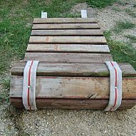 Roll-up sidewalk made from pallet wood and old fire hose. Roll-up sidewalk made from pallet wood and old fire hose.