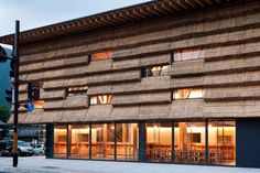"Straw bale and curtain wall. Yusuhara Marche by Kengo Kuma. Thatch is used as a material deeply related to the ""Cha Do,"" tea/restrooms prevalent in the historical town."