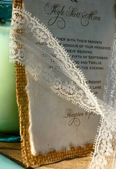 Wedding invites: burlap backing, cream/beige cardstock, brown text, sew cardstock to burlap with one stitch across top (sage thread)