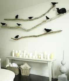 crows on a branch shelf