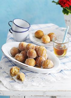 Loukoumades (Greek donuts) One of the pleasures of a Greek holiday comes in those moments after dark (and after dinner) when everyone moves to the tables in a local square to drink coffee and eat plates of tiny cinnamon-scented doughnuts. Whether your preference is for the sugar-dusted variety or those soaked in honey, try making them at home for a crowd-pleasing dessert with a difference.