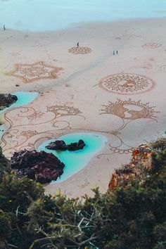 This California Artist Uses A Rake To Create Murals In Beach Sand And They