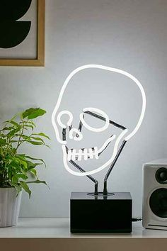 neon skull lamp light UrbanOutfitters.com: Awesome stuff for you & your space