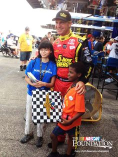 Clint Bowyer poses with Wish Kids Anna and Keishaun at Indianapolis Motor Speedway! #NASCARDreams