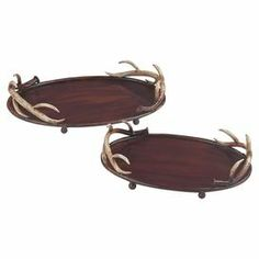 """Adorned with antler-inspired handles, these bronze-finished metal trays highlight eclectic candle arrangements or dinner party cocktails in rustic-chic style.  Product: Small and large trayConstruction Material: MetalColor: BronzeFeatures: Faux horn accentingDimensions: 3"""" H x 11"""" W x 14"""" D (large)Cleaning and Care: Wipe with damp cloth"""