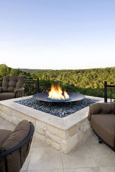 Copper fire pit with stone surround
