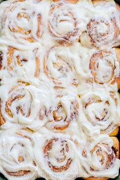 Melt-in-you-mouth overnight cinnamon rolls with whipped cream cheese icing. Perfect for holidays and busy mornings. The best make-ahead cinnamon rolls!   natashaskitchen.com