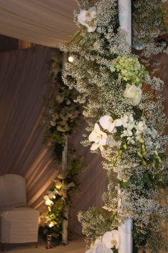 White Phalenopsis Orchids, Gypsophlia (Baby's-Breath) and Hydrangeas wind around the chuppah #weddingflowers #whiteweddingflowers #chuppah #gypsophila