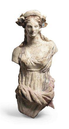 A GREEK TERRACOTTA FRAGMENTARY FEMALE FIGURE -  CANOSAN, HELLENISTIC PERIOD, CIRCA 3RD CENTURY B.C.