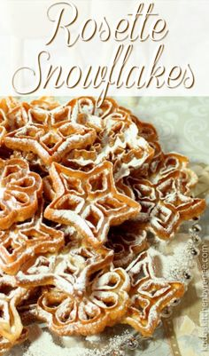 Fried Rosette Snowflake Cookies are light, crispy and utterly delicious! They will snow confectioners sugar down on your shirt with each delectable bite, but that's part of their charm! Rosette Cookies, Snowflake Cookies, Holiday Cookies, Holiday Treats, Best Christmas Recipes, Holiday Recipes, Winter Recipes, Holiday Desserts, Homemade Christmas