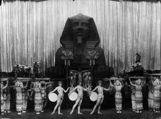Egyptian' dancers in front of a sphinx in 'The Legend of the Nile'  a scene from the Folies Bergere Revue in London  1920