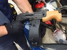 A man has been arrested after he was pulled over and caught with an assault rifle that was loaded with a drum magazine in his backseat.