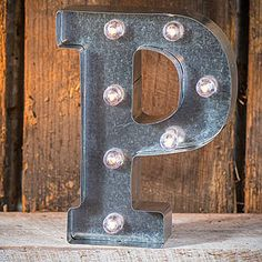 Make a bold statement with our industrial style Light-Up Marquee Letter P. This silver metal letter features lights that will fill your room with vintage charm