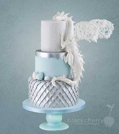 Game of Thrones dragon wedding cake from Black Cherry Cake Company  Wish they would have worked the hind leg into the body a little bit more, but quite lovely.
