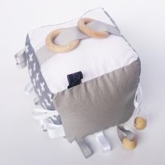 Our Grey Swiss Cross cognitive cubes are the perfect toy for baby and toddler. With sensory ribbon tags, crinkle material, a rattle inside and beech wood rings and beads for teething they will keep baby entertained for hours.