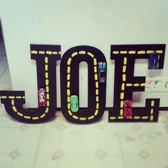 Something to hang up in Joe's race car room! Made with wooden letters, acrylic paint, hot wheels, and hot glue!