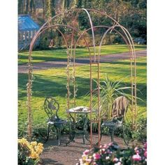 """Garden Ventures Nottingham Gazebo by Garden Ventures. $1121.00. Imagine roses, jasmine or honeysuckle reaching to the top of the four gentle arches of our beautiful Nottingham© gazebo and forming a dome laden with fragrant blossoms and soft foliage! Made of 100% 3/4"""" copper tubing, this handmade gazebo will soften to a warm brown, then gracefully turn to an elegant verdigris."""