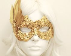 "Handmade Venetian style gold masquerade mask. Front surface is covered with lace. Decorated with gold fabric roses and fishnet tulle on side.  Your order will be delivered in 3-5 business days with online tracking by DHL or UPS. PAYMENT: Following your order placement, you will receive an email from Shopier, which is integrated into Etsy with the Etsy API for payments. You can pay via ""Pay Now"" button in this email.  Back side is covered with fabric for comfortable use. Ribbons are added…"