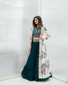 Beautiful bottle green color designer lehenga and blouse with blush pink color long cape. Blouse with floral design hand embroidery work. Cape with floral print. Gown Dress Party Wear, Party Wear Indian Dresses, Designer Party Wear Dresses, Lehnga Dress, Indian Gowns Dresses, Indian Fashion Dresses, Party Wear Lehenga, Kurti Designs Party Wear, Dress Indian Style