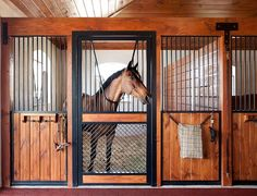 High Stall Front 52: Stall design with bar top; wood and 45-degree crosshatch mesh bottom; Euro-style center and bottom rails in door; V-yoke; and wide door framing.