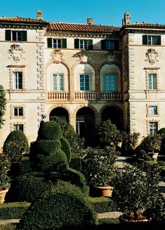 The exterior of the home known as Villa Cetinale includes topiaries, lemon trees, and statues of the four seasons. Photographed by François Halard, Vogue, April 2005.