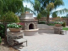Southwestern exterior Patio Design Ideas | Southwestern Outdoor FireplaceBuilt-In SeatingPoco Verde ...