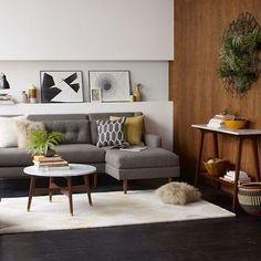 Gray sofa, dark floors, wood and light walls