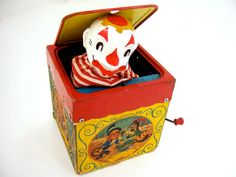 Jack-in-the-box vintage tin toy, fun creepy clown makes children jump, crank plays music Pop Goes the Weasel, antique red yellow blue white Creepy Carnival, Creepy Clown, Big Joke, Pop Goes The Weasel, Mulberry Bush, Family Tree Chart, New Kids Toys, Cardboard Toys, Circus Art
