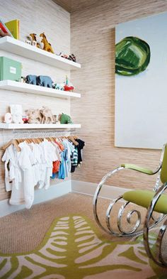 Add a rail under an IKEA floating shelf to create a makeshift hanger for onesies in the nursery.