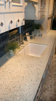 Vetrazzo recycled glass countertop. I have been looking at this product since it came out. I like the neutrals the best because it looks less busy.