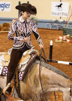 Lovely jacket design and the colors complement her horse nicely without being eye-searing-