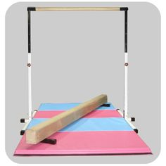 Little Gym: White Horizontal Bar - Tan Balance Beam - Pink/Light Blue Mat. Get your gymnast an added boost with in-home training!
