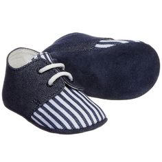 Baby boys Fendi pre-walker trainers, made in blue and white striped denim. They have laces to fasten, a soft leather lining and padded leather inner soles. A fun cactus and the designer's name are embroidered onto one of the flexible, blue suede leather outer soles.