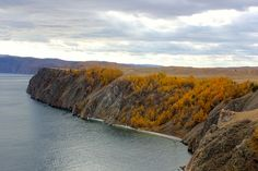 Standing atop the cliffs overlooking Lake Baikal on the northern end of Olkhon Island. There are actually freshwater seals that live in the lake but unfortunately, we've not been able to see any so far up to this point. Lake Baikal Russia, Seals, Fresh Water, Island, Live, Travel, Outdoor, Outdoors, Viajes