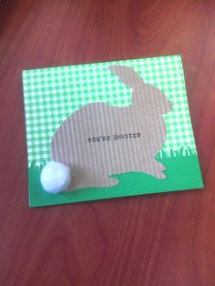 invites for bunny birthday party---green ginham paper, green grass paper made with grass punch (fiskars), brown patterned paper (crimped) and a white pom pom tail.