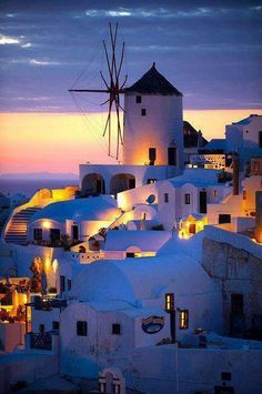 Oia ( Ia ) Santorini - Windmills and town at sunset, Greek Cyclades islands - Photos, pictures and images Places To Travel, Places To See, Travel Destinations, Beautiful Places To Visit, Wonderful Places, Dream Vacations, Vacation Spots, Italy Vacation, Myconos