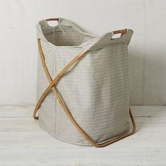 Always looking for a good looking, functional place to put laundry.  LOVE THIS. (comes in smaller size, too)  Bamboo Laundry Hamper - Double #WestElm