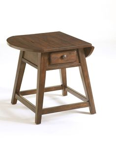 Attic Heirlooms Splay Leg Table   For a casual accent in your traditional décor, choose the Attic Heirlooms Splay Leg Table. It features your choice of Natural Oak and Rustic Oak stains. Its drop-leaf sides and a front drawer provide extra space for essentials in your family room, or perhaps in your bedroom.