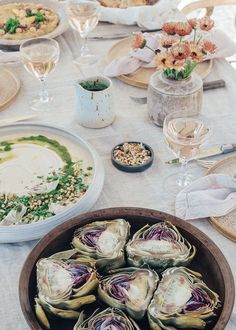 Light summer meal with hummus and baked artichokes served with pale rosé wine.