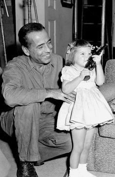 Humphrey Bogart with his daughter Leslie, c. 1955