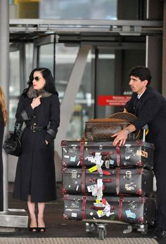 Dita Von Teese in Paris 2009~~love that she DOES NOT travel light! ;)