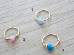 This listing is for ONE or more tiny dainty 14k gold filled hoop with tiny 3mm loose Fire Opal bead.  If you buy more than one you get a discount (please take a look at the style options)!!!  ★★★Please choose your style. size:  gauge: 22g. inner diameter:8mm.  FOR different size please contact me.  ★To open the ring gently twist the ends sideways, slip into the hole and then gently twist the ends back for a continuous hoop.  ★PLEASE NOTE: All pieces are created by hand, so there can be…