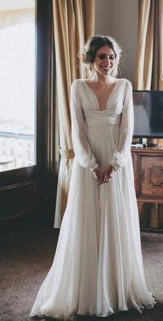 Chic vintage inspired cuffed long-sleeve empire waist wedding dress; Featured Dress: Paolo Sebastian