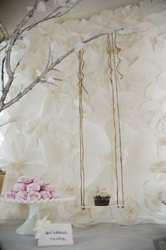 This was a baby shower with a theme inspired by the classic children's book, The Secret Garden. I knew I wanted to play with texture rather than color, and immediately knew I wanted to make a backdrop of paper flowers inspired by the Chanel 2009 runway show. It was lightweight, inexpensive, and gorgeous! (Looks awesome hanging on my bedroom wall now, too.)