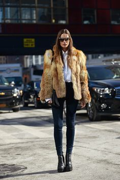 Street Style | Fur coat styled with a crisp white button-down shirt, skinny jeans, and chunky ankle boots @StyleCaster